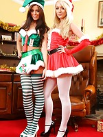 Natalia and Alana tease each other out of their Kinky Christmas outfits.